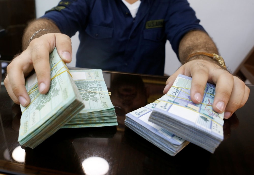 A money exchange vendor displays Lebanese pound banknotes at his shop in Beirut, Aug. 16.