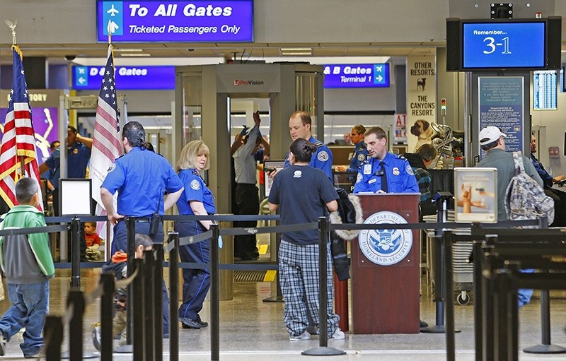 Passengers enter a security checkpoint with a full body scanner at the Salt Lake International Airport, in Salt Lake City, Utah, USA, 07 January 2010 (EPA File Photo)