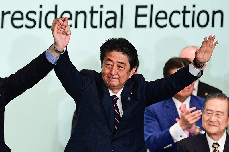 Japan's Prime Minister Shinzo Abe celebrates after the ruling liberal Democratic Party (LDP) leadership election at the party's headquarters in Tokyo on Sept. 20, 2018. (AFP Photo)