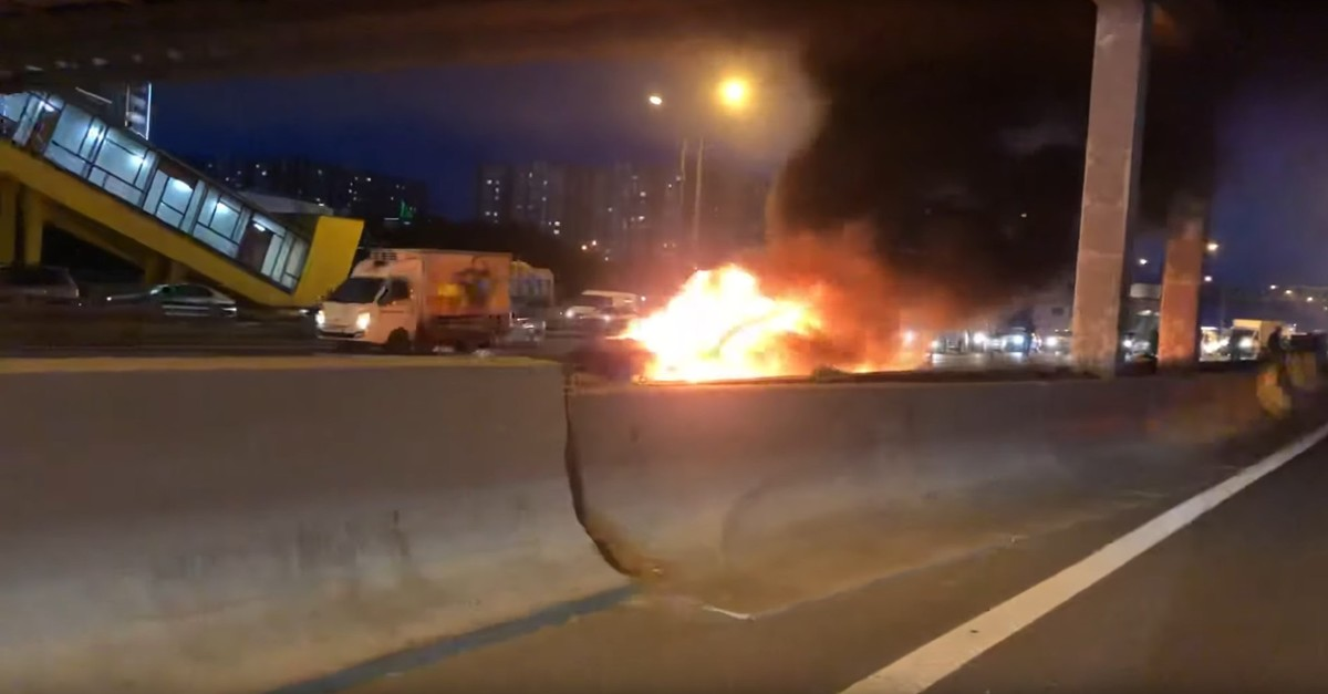 Screengrab from a video shared on social media shows a Tesla Model 3 burning on a Moscow highway, Aug. 11, 2019. (Video courtesy of youtube/mr.medvedev)