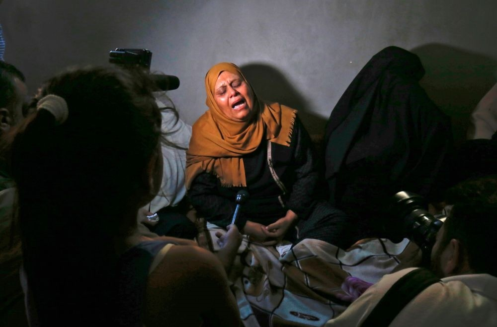 The mother of Palestinian Ahmed Omar, who was killed during a protest near the Israeli Erez crossing with the Gaza Strip, mourns on Sept. 19.