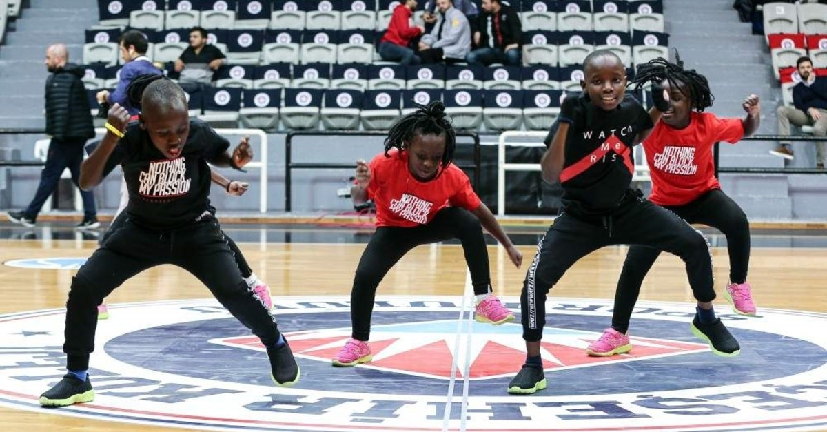 Masaka Kids Africana performs at a sports hall during a local basketball game, Istanbul, Dec. 18, 2019. (AA Photo)