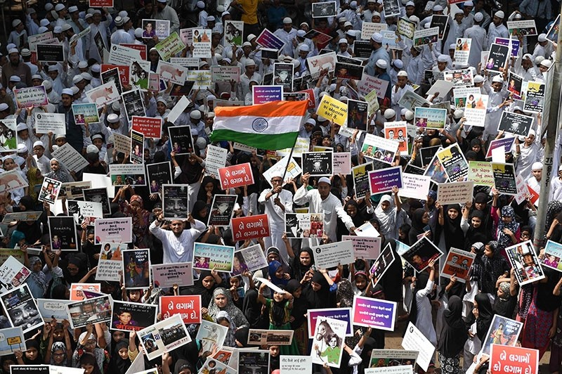 This photo taken on April 15, 2018 shows Indian students in Ahmedabad protesting in support of rape victims in Jammu and Uttar Pradesh. (AFP Photo)