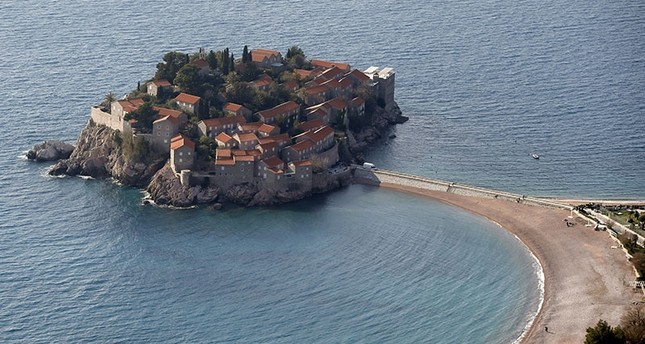 This photo taken Wednesday, March 15, 2017, shows the Sveti Stefan peninsula, a hotel and a tourist resort on the coast of Montenegro. (AP Photo)