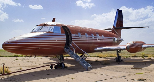 This undated photo provided by GWS Auctions, Inc. shows a private jet once owned by Elvis Presley, on a runway in New Mexico. (AP Photo)