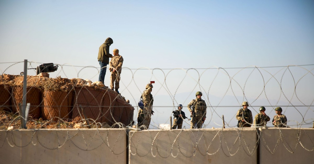 Turkish soldiers gather near the border with Syria during a symbolic demonstration in the city of Harim in the northern countryside of Syria's Idlib on the border with Turkey on Jan. 2, 2020