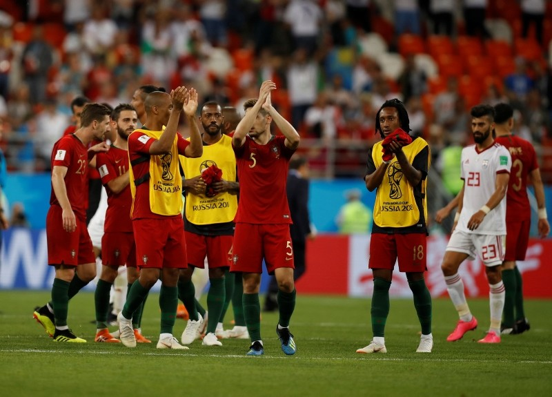Members of the Portugal team wave to the fans after the end of the group B match between Iran and Portugal at the 2018 soccer World Cup. (AP Photo)