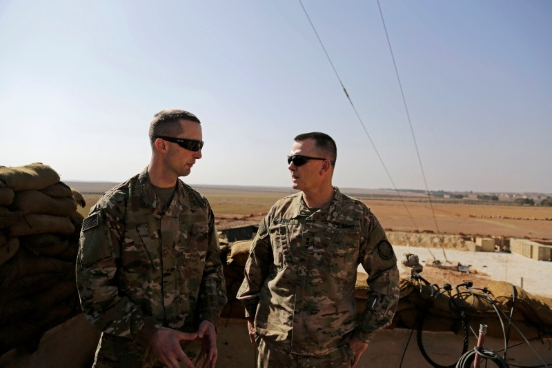 U.S. Army Capt. Timothy Skinner (L) and Lt. Gen. Paul E. Funk consult at an American outpost in Manbij, northern Syria, Feb. 7.