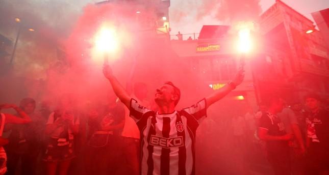 Besiktas fans support their team out of the stadium before the Turkish Super League match between Besiktas and Antalyaspor in Istanbul, Turkey, 13 August 2017.(EPA Photo)