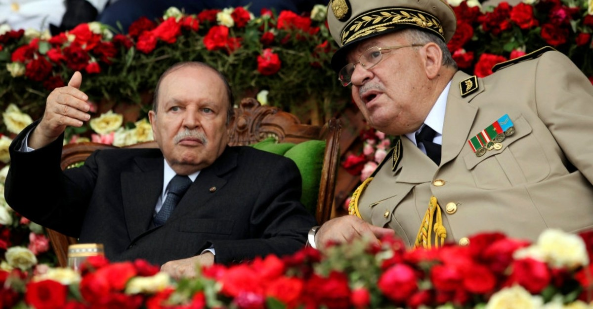 Algeria's President Abdelaziz Bouteflika gestures while talking with Army Chief of Staff General Ahmed Gaed Salah, Cherchell, June 27, 2012.