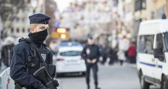 Strasbourg's Christmas market reopens under the protection of police after deadly terror attack, Strasbourg, Dec. 15.