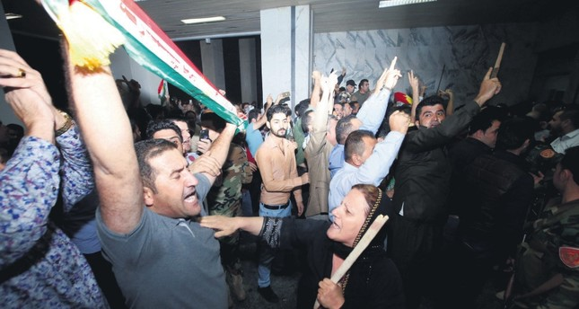 Demonstrators gather outside the KRG parliament building in Irbil, Iraq, Oct. 29.