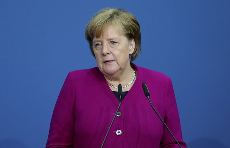 German Chancellor and Christian Democratic Union (CDU) party leader Angela Merkel speaks prior to the signing of the coalition agreement of Christian Democratic Union (CDU), Christian Social Union (CSU) and the SPD in Berlin (EPA Photo)