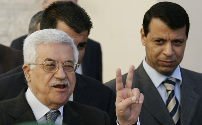 Palestinian Authority President Mahmoud Abbas is accompanied by former Fatah strongman Mohammad Dahlan in this archive photo (on left). Hamas, led by Ismail Haniyeh, extended an olive branch to the Abbas administration last week.