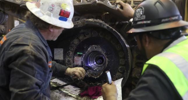 Mechanics work on mining equipment at the Black Butte coal mine outside Rock Springs.