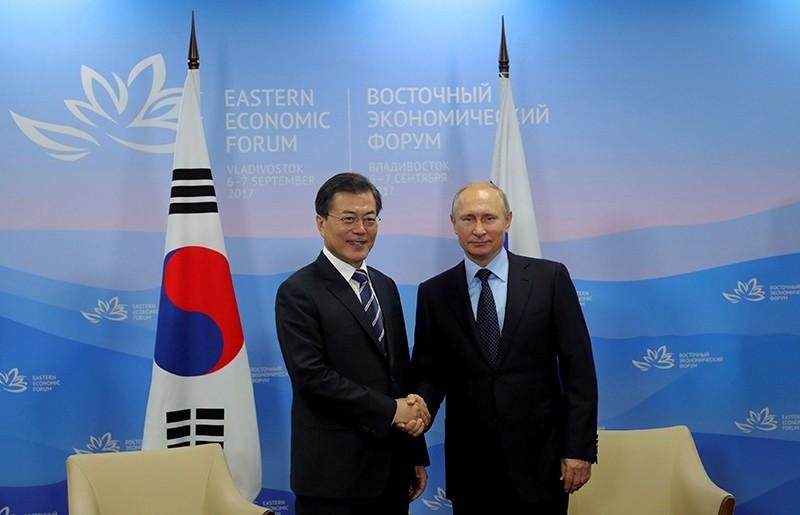 Russian President Vladimir Putin and his South Korean counterpart Moon Jae-in shake hands during a meeting at the Eastern Economic Forum in Vladivostok, Russia, Sept. 6, 2017. (Kremlin via Reuters)