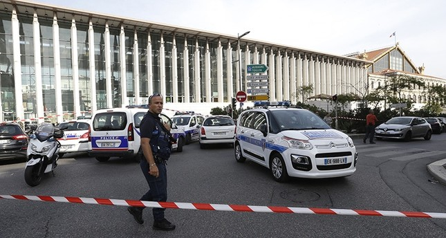 A French police officer cordons off the access to Marseille 's main train station Sunday, Oct. 1, 2017 in Marseille, southern France. (AP Photo)