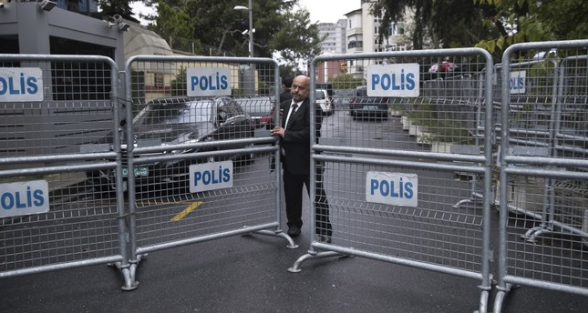 A guard secures the entrance to the Saudi Consulate in Istanbul. A Turkish newspaper yesterday published a gruesome recounting of the slaying of Saudi writer Jamal Khashoggi at the consulate.