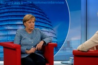 Özil's racism complaints need to be taken seriously, Merkel says