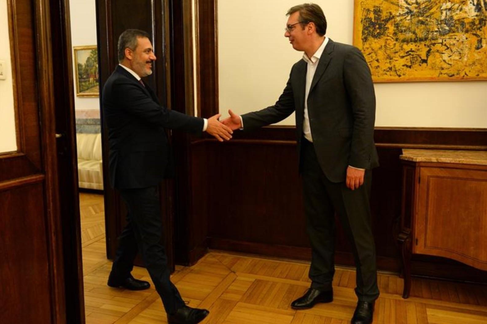 Turkey's Fidan (L) and Vucic