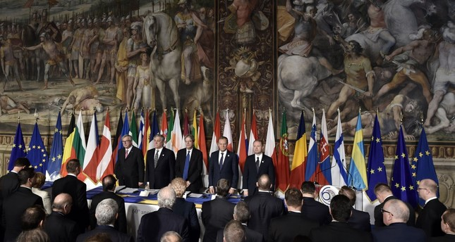 EU officials stand with the leaders of 27 European Union countries during a summit of EU leaders to mark the 60th anniversary of the bloc's founding Treaty of Rome, at Rome's Piazza del Campidoglio (Capitoline Hill), March 25, 2017.
