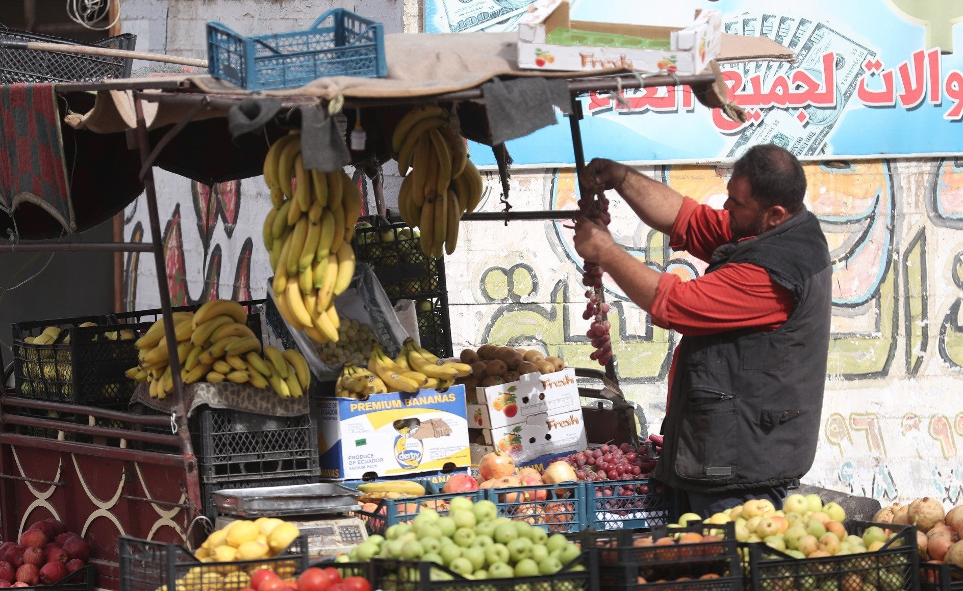 A fruit vendor sells his produce in the town of Binnish, northwestern Idlib province, Oct. 15.