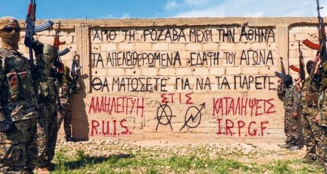The slogans on the wall are signed by militant organizations The Revolutionary Association of Internationalist Solidarity (RUIS) and Internationalist Revolutionary People's Rebel Forces (IRPGF)
