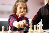 In the province of Elazığ in eastern Turkey, a seven-year-old girl sits at a chessboard with her sister engaged in a prolonged and fierce battle of the mind. While the two girls are engage in this...