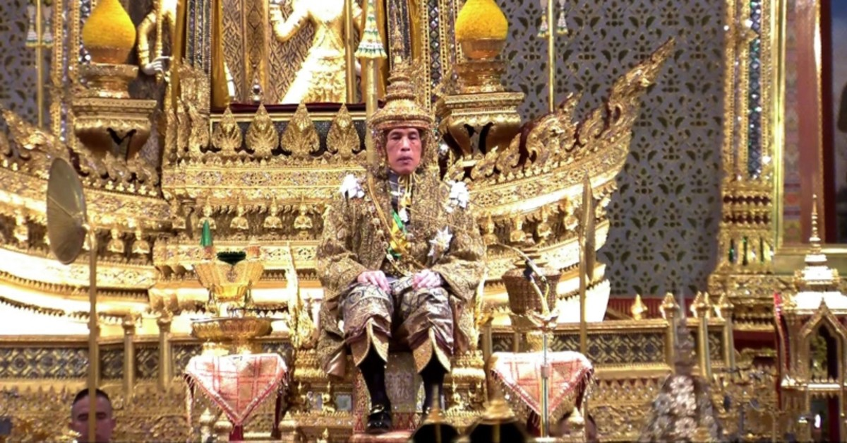 This screengrab from Thai TV Pool video taken on May 4, 2019 shows Thailand's King Maha Vajiralongkorn facing the audience wearing the gold crown while sitting on the throne during his coronation at the Grand Palace in Bangkok. (AFP Photo)