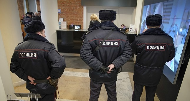 Russian police visit the Pioner movie theater in Moscow, Russia, Friday, Jan. 26, 2018. (AP Photo)