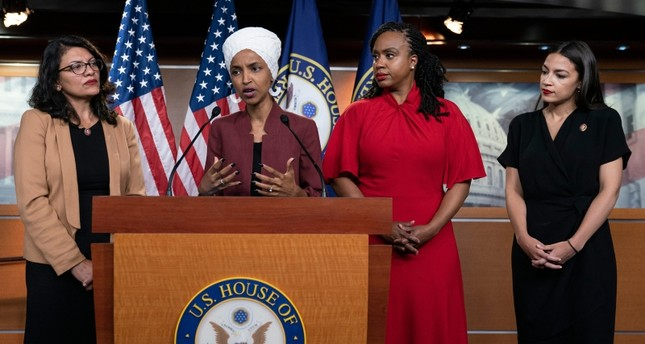 From left, U.S. Reps. Rashida Tlaib, D-Mich., Ilhan Omar, D-Minn., Ayanna Pressley, D-Mass., and Alexandria Ocasio-Cortez, D-N.Y., respond to base remarks by President Donald Trump (AP Photo)