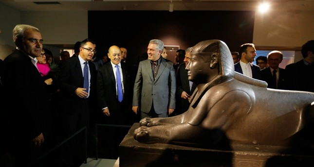 French Foreign Minister Jean-Yves Le Drian (C) and Vice President of Iran Head of Cultural Heritage Ali Asghar Mounesan (C-R) and Louvre museum President Jean-Luc Martinez (C-L) tour an exhibition of 50 artworks from the Louvre (EPA Photo)