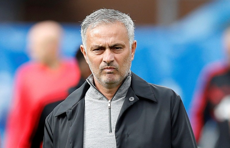 Mourinho walks, prior to the start of the soccer match between Burnley and Manchester United, at Turf Moor, in Burnley, England, Sunday, Sept. 2, 2018. (AP Photo)