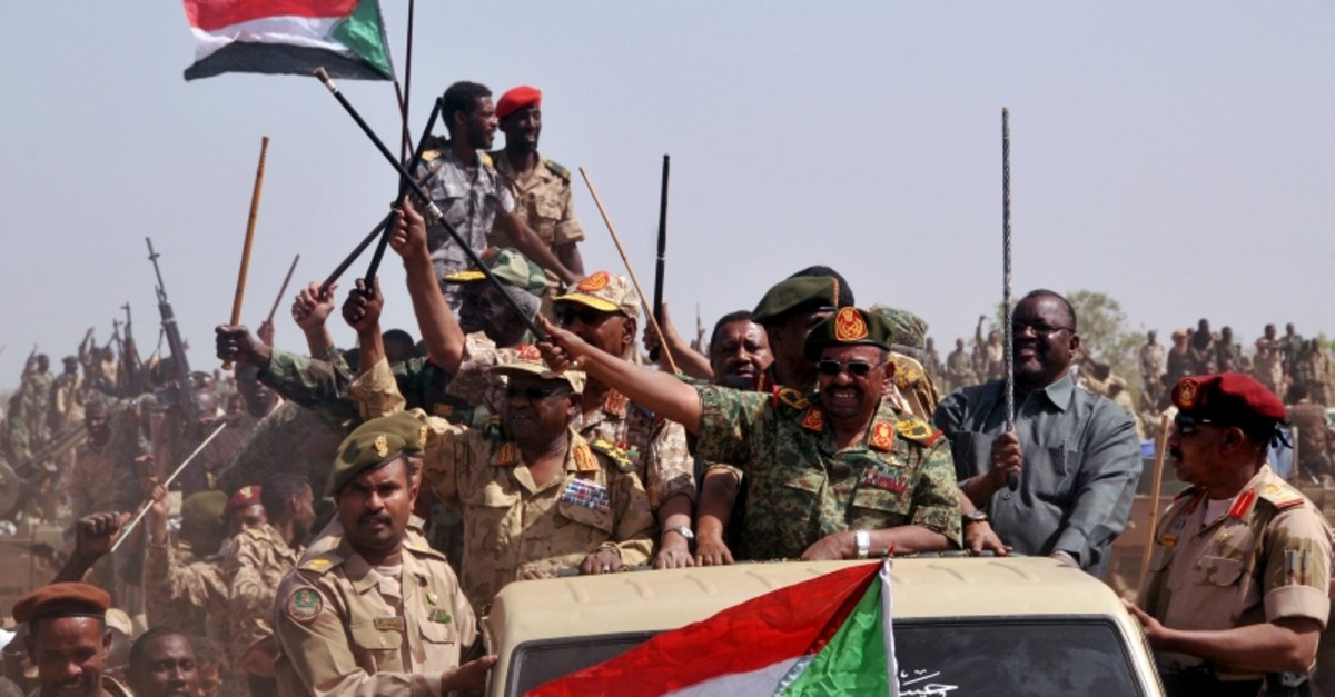 This file photo shows Sudanese President Omar Hassan al-Bashir waving as he leads victory celebrations after the Sudanese Armed Forces (SAF) defeated the JEM rebels during his visit to the battle area in South Darfur April 28, 2015. (Reuters Photo)