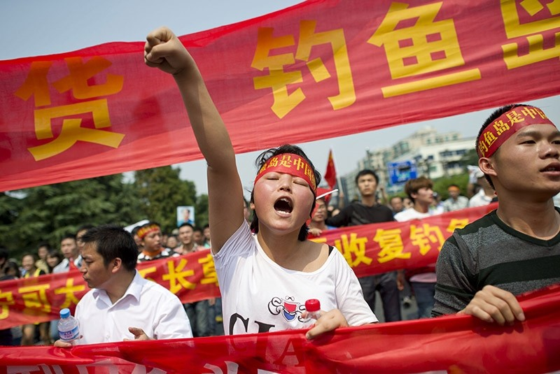 A Chinese demonstrator shouts slogans during a protest against Japan's ,nationalizing, of Diaoyu Islands, also known as Senkaku in Japan, in Hangzhou, east China's Zhejiang province. (AFP File Photo)