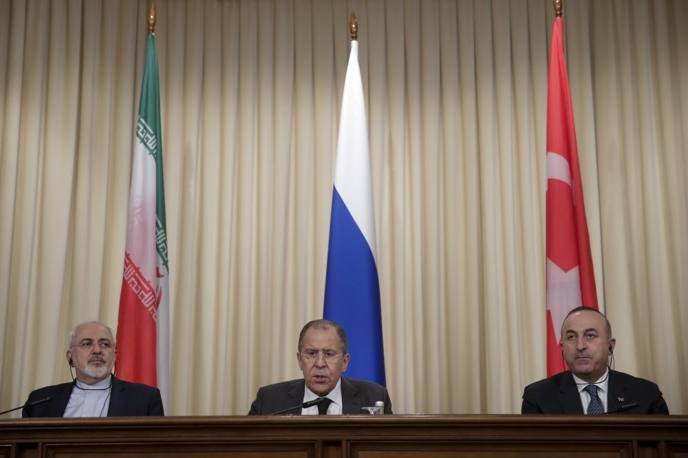 Iranian Foreign Minister Mohammed Javad Zarif (L), Russian Foreign Minister Sergey Lavrov (C) and Turkey's Foreign Minister Mevlu00fct u00c7avuu015fou011flu at a joint news conference after their talks of in Moscow.