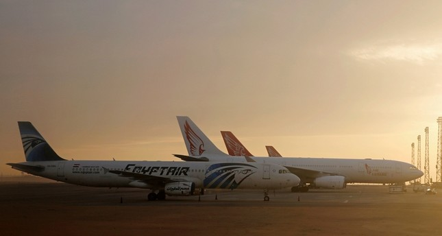 An EgyptAir plane is parked next to other planes on the runway of the Cairo International Airport, pictured through the window of an Etihad Airways plane in Egypt December 16, 2017 (Reuters File Photo)