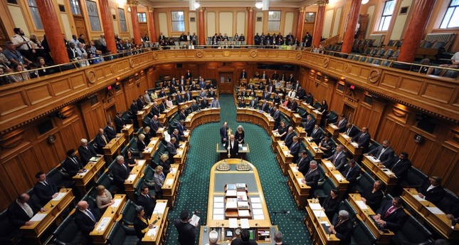 Parliament members attend the New Zealand Parliament session to pay their respects to those who lost their lives in the Christchurch mosque attacks, in Wellington on March 19, 2019. (AFP Photo)