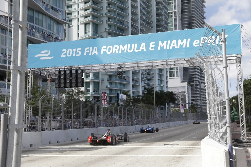 Cars race on downtown Miami streets during the Formula E Miami ePrix auto race in Miami on March 14, 2015.