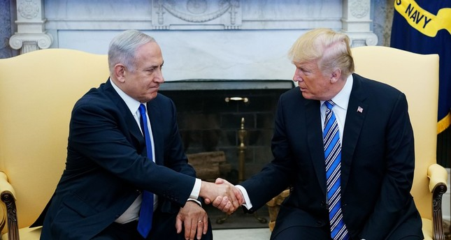 Donald Trump shakes hands with Israel's Prime Minister Benjamin Netanyahu in the Oval Office of the White House (AFP Photo)