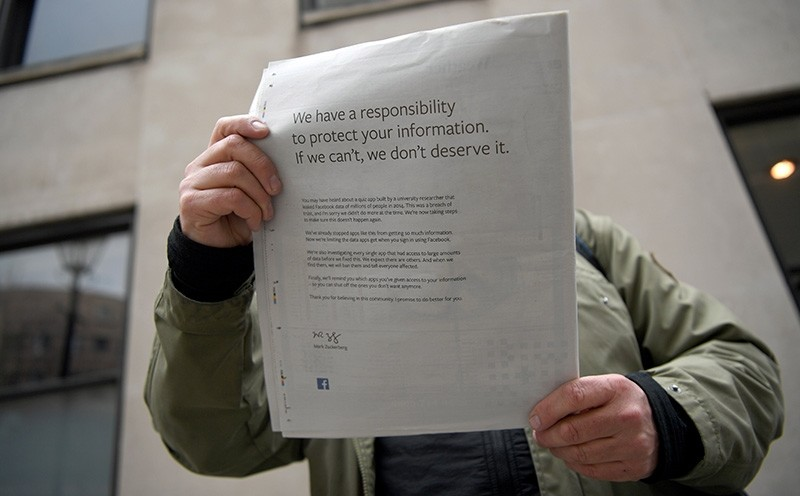 A copy of 'The Observer' shows an advertisement paid by Facebook in London, Britain, March 25, 2018. (EPA Photo)