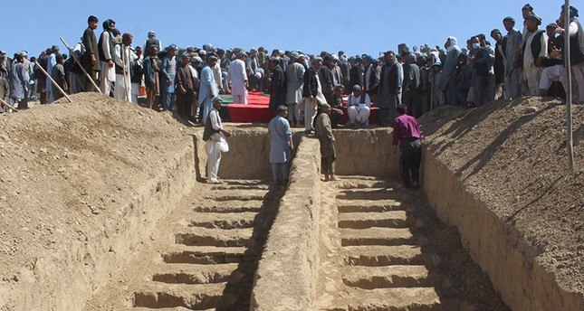 Graves are prepared for the burial of civilians, who were killed by insurgents at Mirza Olang village, in Sar-i-Pul province, Afghanistan, August 16, 2017. (Reuters Photo)