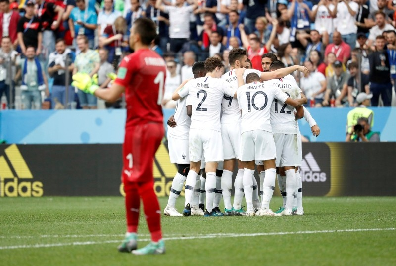 France's players celebrate their side's 2nd goal scored by Antoine Griezmann during the quarterfinal match between Uruguay and France at the 2018 soccer World Cup in the Nizhny Novgorod Stadium, in Nizhny Novgorod, Russia, July 6, 2018. (AP Photo)