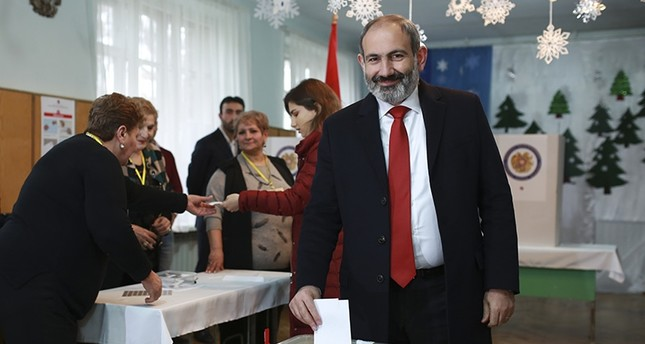 Acting Armenian Prime Minister Nikol Pashinian casts his ballot in a polling station during an early parliamentary election in Yerevan, Armenia, Sunday, Dec. 9, 2018. (AP Photo)