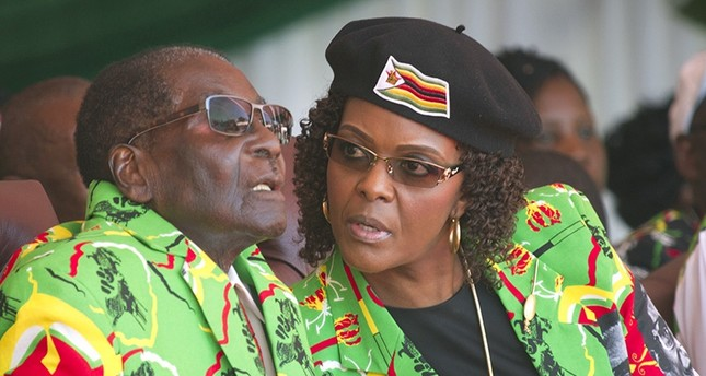 In this June, 2, 2017 file photo Zimbabwean President Robert Mugabe, left, and his wife Grace follow proceedings during a youth rally in Marondera Zimbabwe (AP Photo)