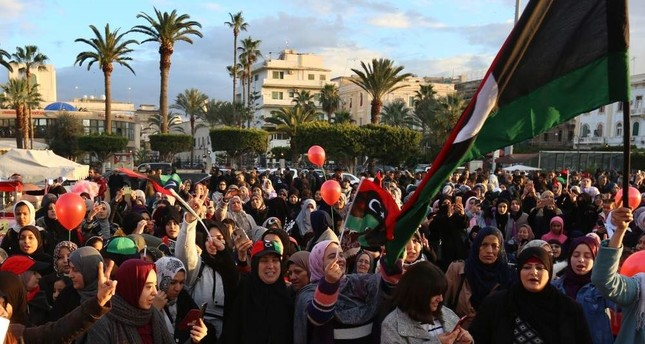 Libyan people in the capital Tripoli welcome the announcement of a cease-fire, Jan. 10, 2020. AA
