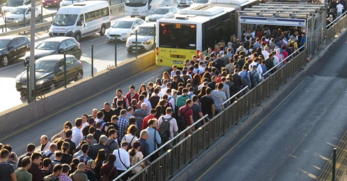 People enter and leave a metrobus station in Altunizade district of Istanbul, Oct. 3, 2019. Istanbul remains Turkey's most populated city with a population of over 15.5 million people. (DHA Photo)