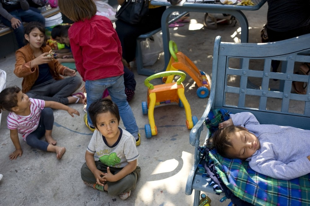 A child from the Mexican state of Michoacan looks on while sitting in the patio of the Centro Madre Assunta, a shelter for migrant women and children, in Tijuana, Mexico.