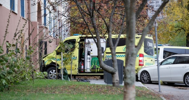 A damaged ambulance is seen parked after an incident in the center of Oslo, Tuesday, Oct. 22, 2019 (AP Photo)