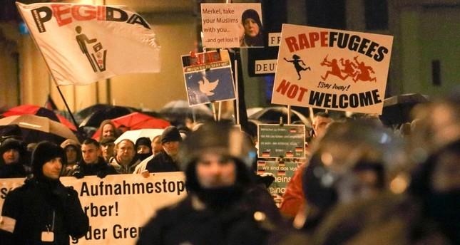 Members of Legida, the Leipzig arm of the anti-Islam PEGIDA, take part in a rally in Leipzig, Germany on Jan. 11, 2016. (Reuters Photo)